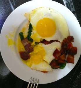 Sunny eggs over bacon, spinach & tomatoes